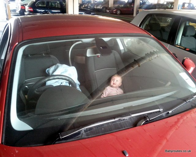 Image of baby in car on long car journey