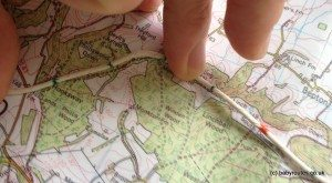 Use a piece of string with markers on it to measure hiking distances on a map