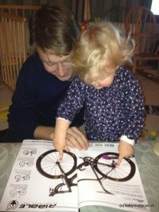 Like father, like daughter...and those bike wheels look expensive.220 Triathlon magazine reading with kid