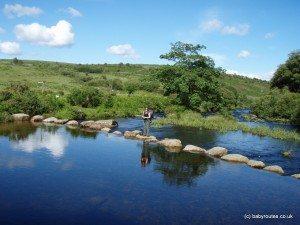 Crossing a river on stone steps, Dartmoor, Devon