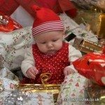 Christmas baby in amongst presents