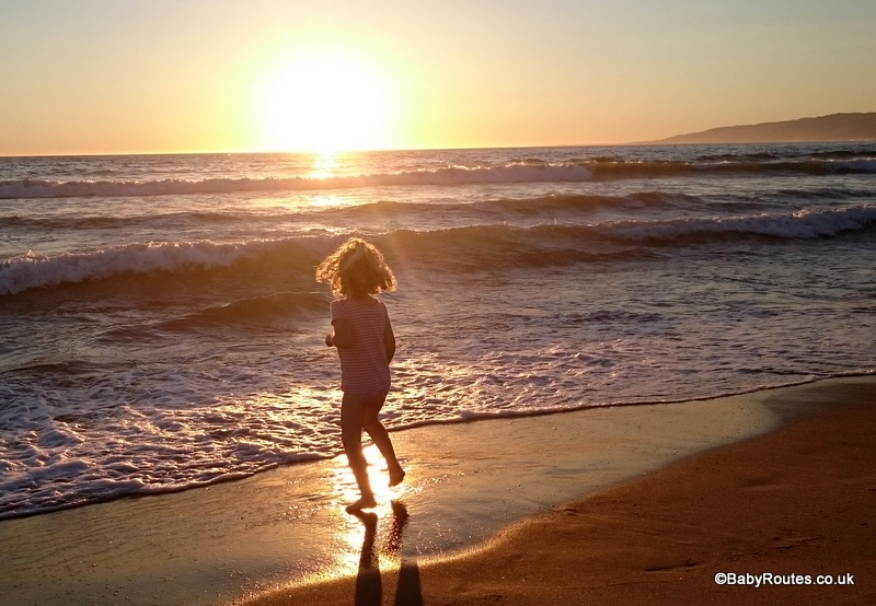Child paddling at sunset, 8 Fun Things to do with young children in Santa Monica