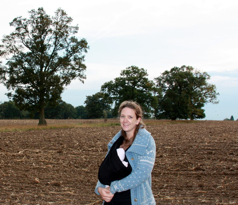 Field walk with baby at five days old