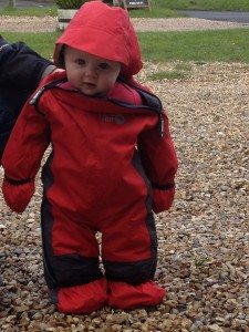 Baby modelling Spotty Otter waterproof fleece-lined splashsuit