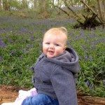 Baby in the bluebells at Shiplake Copse