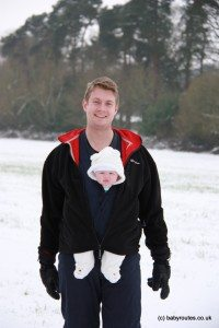 Winter walk with a baby in a carrier