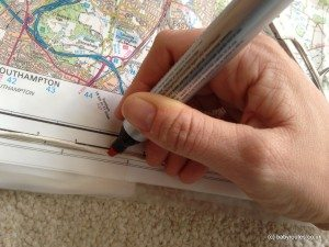 Mark distances along a piece of string to measure distances on a map