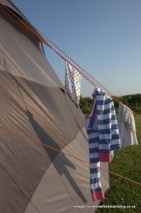 clothes hanging on a tent