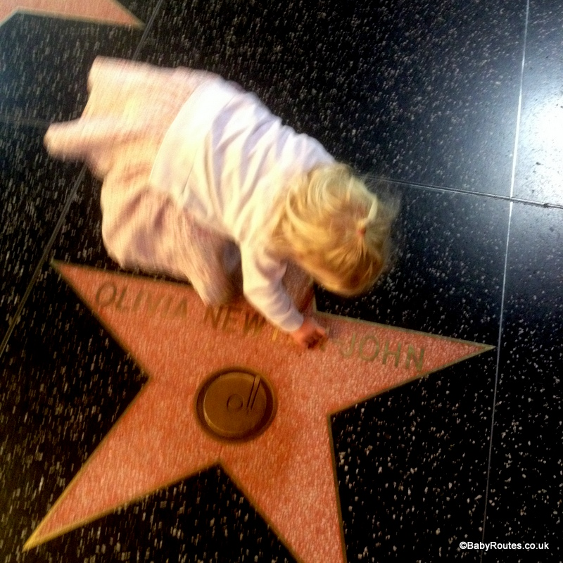 Beth checking out Olivia Newton John's star, Hollywood Walk of Fame, LA, California